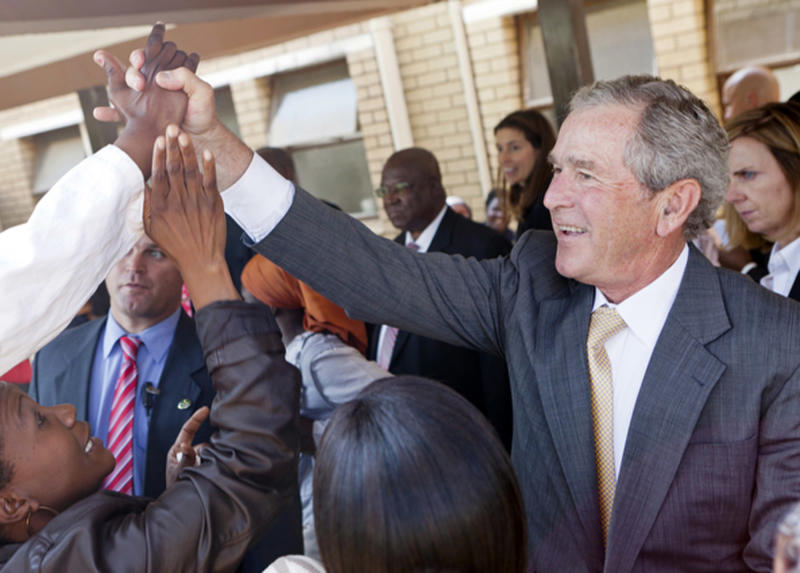 FILE - In this July 5, 2012 file photo provided by the George W. Bush Presidential Center, former President George W. Bush and his wife, Laura Bush stop to talk with people who have lined the hallways of the Princess Marina Hospital in Gaborone, Botswana. The government spent nearly $3.7 million on former presidents in 2012, according to an analysis just released by the nonpartisan Congressional Research Service. That covers a pension, compensation and benefits for office staff, and other costs like travel, office space and postage. The costliest former president? George W. Bush, who clocked in last year at just over $1.3 million. (AP Photo/George W. Bush Presidential Center, Shealah Craighead, File)