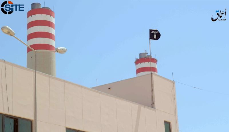 An Aamaq News Agency image allegedly shows an Islamic State flag on a power plant in Sirte (AFP Photo/)