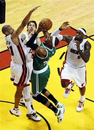 Boston Celtics' Paul Pierce (34) drives to the basket surrounded by Miami Heat's Shane Battier (31), Mike Miller (13) and LeBron James (6) during the first half of Game 5 in their NBA basketball Eastern Conference finals playoffs series, Tuesday, June 5, 2012, in Miami. (AP Photo/Wilfredo Lee)
