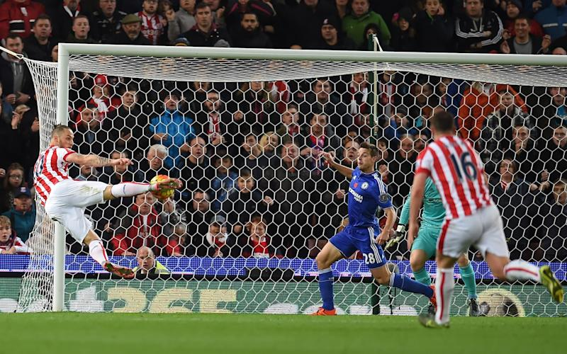 Stoke City's Austrian striker Marko Arnautovic (L) shoots to score the opening goal of the English Premier League football match between Stoke City and Chelsea at the Britannia Stadium in Stoke-on-Trent, central England on November 7, 2015. AFP PHOTO / PAUL ELLIS RESTRICTED TO EDITORIAL USE. No use with unauthorized audio, video, data, fixture lists, club/league logos or 'live' services. Online in-match use limited to 75 images, no video emulation. No use in betting, games or single club/league/player publications..PAUL ELLIS/AFP/Getty Images - Credit: PAUL ELLIS/AFP/Getty