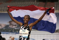 Netherland's Sifan Hassan jubilates after setting a new world record during the One Hour Women at the Diamond League Memorial Van Damme athletics event at the King Baudouin stadium in Brussels on Friday, Sept. 4, 2020. (AP Photo/Virginia Mayo)