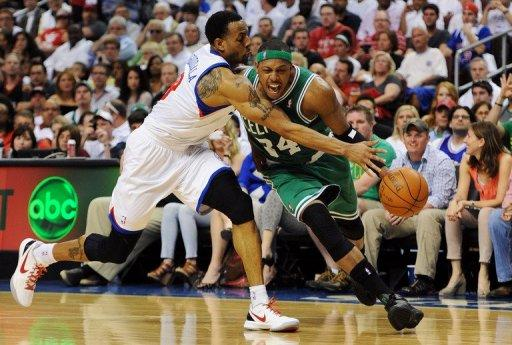 Philadelphia 76ers' Andre Iguodala (L) finished with 16 points, seven rebounds and four assists