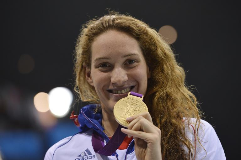 France's gold medalist Camille Muffat celebrates on the podium after winning the women's 400m freestyle swimming event at the London 2012 Olympic Games on July 29, 2012