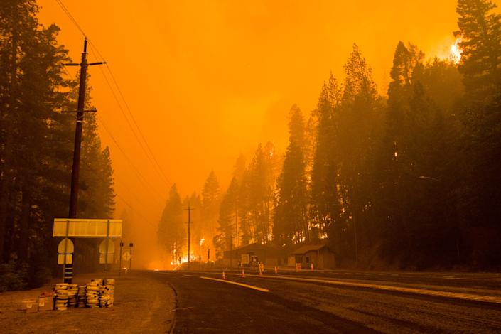 CALIFORNIA, UNITED STATES - 2021/07/24: Active flames reach highway 70. The Dixie fire continues to burn in California burning over 180,000 acres with 20% containment. (Photo by Ty O'Neil/SOPA Images/LightRocket via Getty Images)