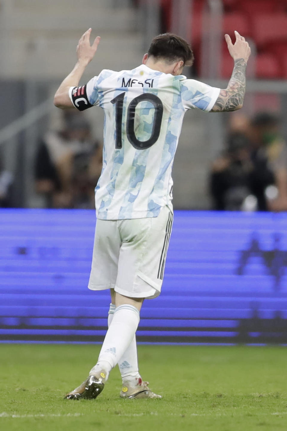 Blood is seen in an ankle of Argentina's Lionel Messi as he reacts during a Copa America semifinal soccer match against Colombia at the National stadium in Brasilia, Brazil, Tuesday, July 6, 2021. (AP Photo/Eraldo Peres)
