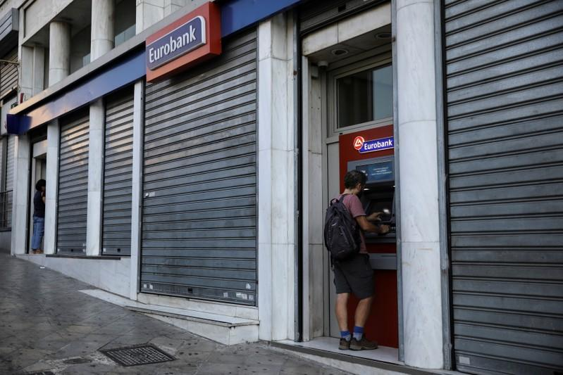 Eurobank, NBG report higher profits as they tackle bad loans