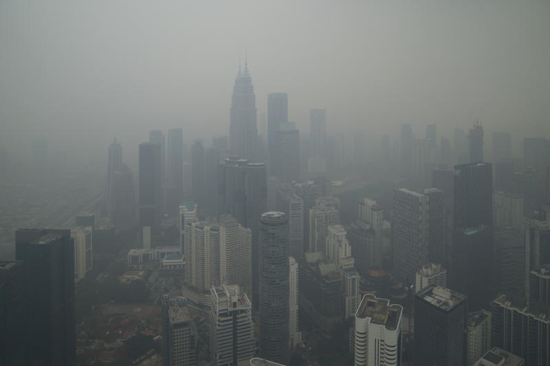 Kuala Lumpur city stands shrouded with haze in Kuala Lumpur, Malaysia, Friday, Sept. 13, 2019. Malaysian authorities plan to conduct cloud-seeding activities to induce rain to ease the haze. The government said it will press Jakarta to take immediate action to put out the burning forests and ensure the fires won't occur again. (AP Photo/Vincent Thian)