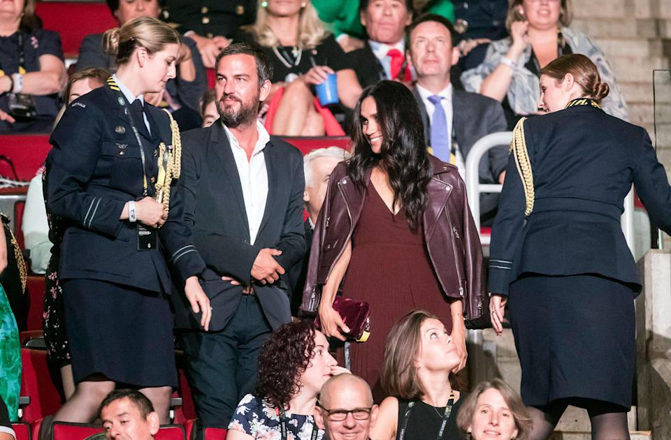 Meghan's maroon dress has seen rise in searches for the colour [Photo: Getty]