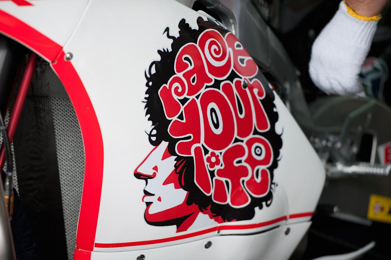 VALENCIA, SPAIN - NOVEMBER 04: A tribute to Italian rider Marco Simoncelli is displayed on the bike of Yuki Takahashi of Japan and Gresini Racing Moto2 as engineers work in the team garage during the free practice of MotoGP of Valencia at Ricardo Tormo Circuit on November 4, 2011 in Valencia, Spain.  (Photo by Mirco Lazzari gp/Getty Images)