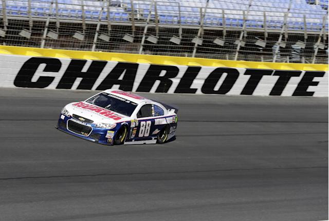 Dale Earnhardt Jr. drives his car out of Turn 4 during NASCAR Sprint Cup auto race testing for the 2014 season at Charlotte Motor Speedway in Concord, N.C., Wednesday, Dec. 11, 2013. (AP Photo/Chuck Burton)