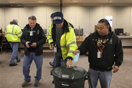 Union members cast their ballots at the International Association of Machinists District 751 Headquarters during a union vote in Seattle, Washington by the association's members on a proposed contract by the Boeing Company to build the 777X jetliner November 13, 2013. REUTERS/David Ryder