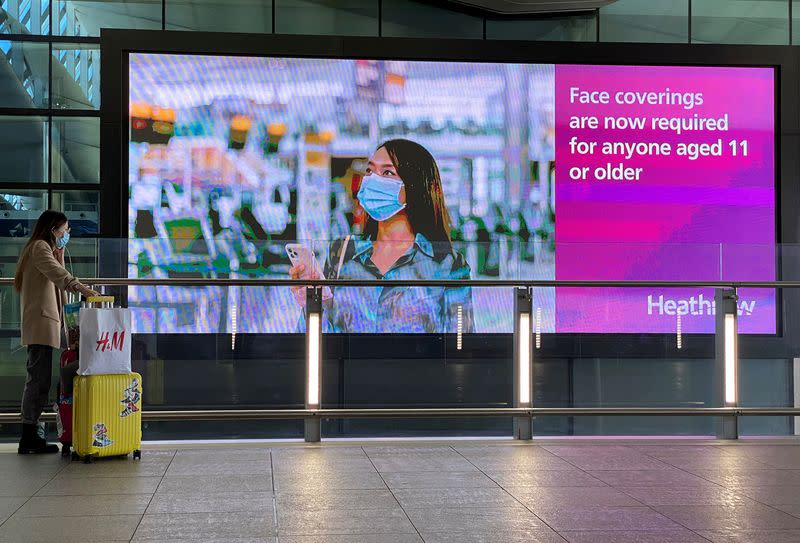 A public health campaign message is seen at Heathrow Airport, following the outbreak of the coronavirus disease (COVID-19), London, Britain