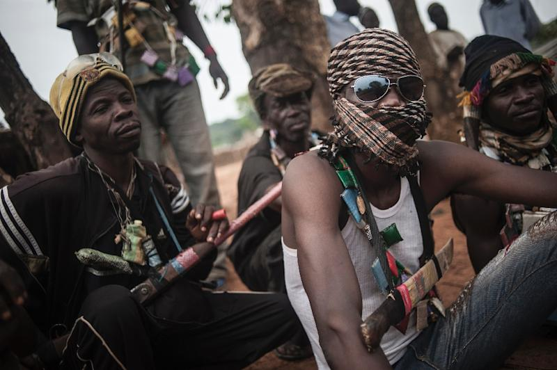 Anti-Balaka militia members rest on the outskirts of Bambari, on July 31, 2014