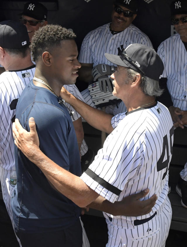 New York Yankees pitcher Luis Severino, left, talks with Ron Guidry before the Old Timers' Day baseball game Sunday, June 17, 2018, at Yankee Stadium in New York. (AP Photo/Bill Kostroun)