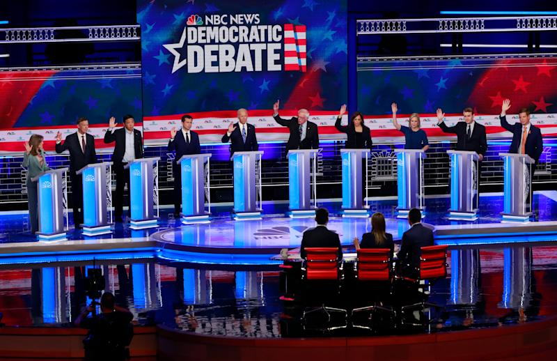 Democratic presidential candidates raise their hands when asked if they would provide healthcare for undocumented immigrants, during the Democratic primary debate hosted by NBC News at the Adrienne Arsht Center for the Performing Arts in Miami, June 27, 2019.