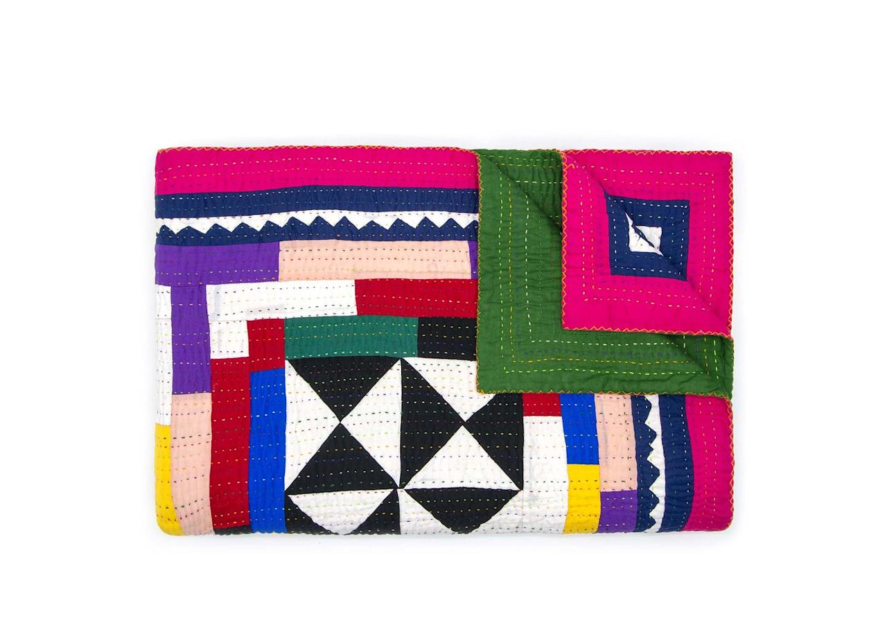 "<p>A vibrant, geometric blanket makes an artful addition to any home; when you aren't too busy admiring how beautiful it looks draped over your sofa, it will be your favourite quilt to snuggle under.</p><p>£325, <a href=""https://www.vam.ac.uk/shop/"" target=""_blank"">V&A</a>.</p>"