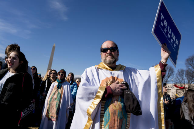 <p>Lis Kelly of Notre Dame, Ind., background, and her friend Brother Tomasio Venditti of Steubenville, Ohio, right, wear white gowns depicting the Lady of Guadalupe the Roman Catholic title of the Blessed Virgin Mary during an anti-abortion rally on the National Mall in Washington, Friday, Jan. 19, 2018, during the annual March for Life. Thousands of anti-abortion demonstrators gather in Washington for an annual march to protest the Supreme Court's landmark 1973 decision that declared a constitutional right to abortion. (Photo: Andrew Harnik/AP) </p>