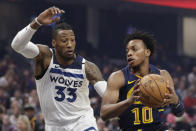 Cleveland Cavaliers' Darius Garland (10) drives past Minnesota Timberwolves' Robert Covington (33) in the first half of an NBA basketball game, Sunday, Jan. 5, 2020, in Cleveland. (AP Photo/Tony Dejak)