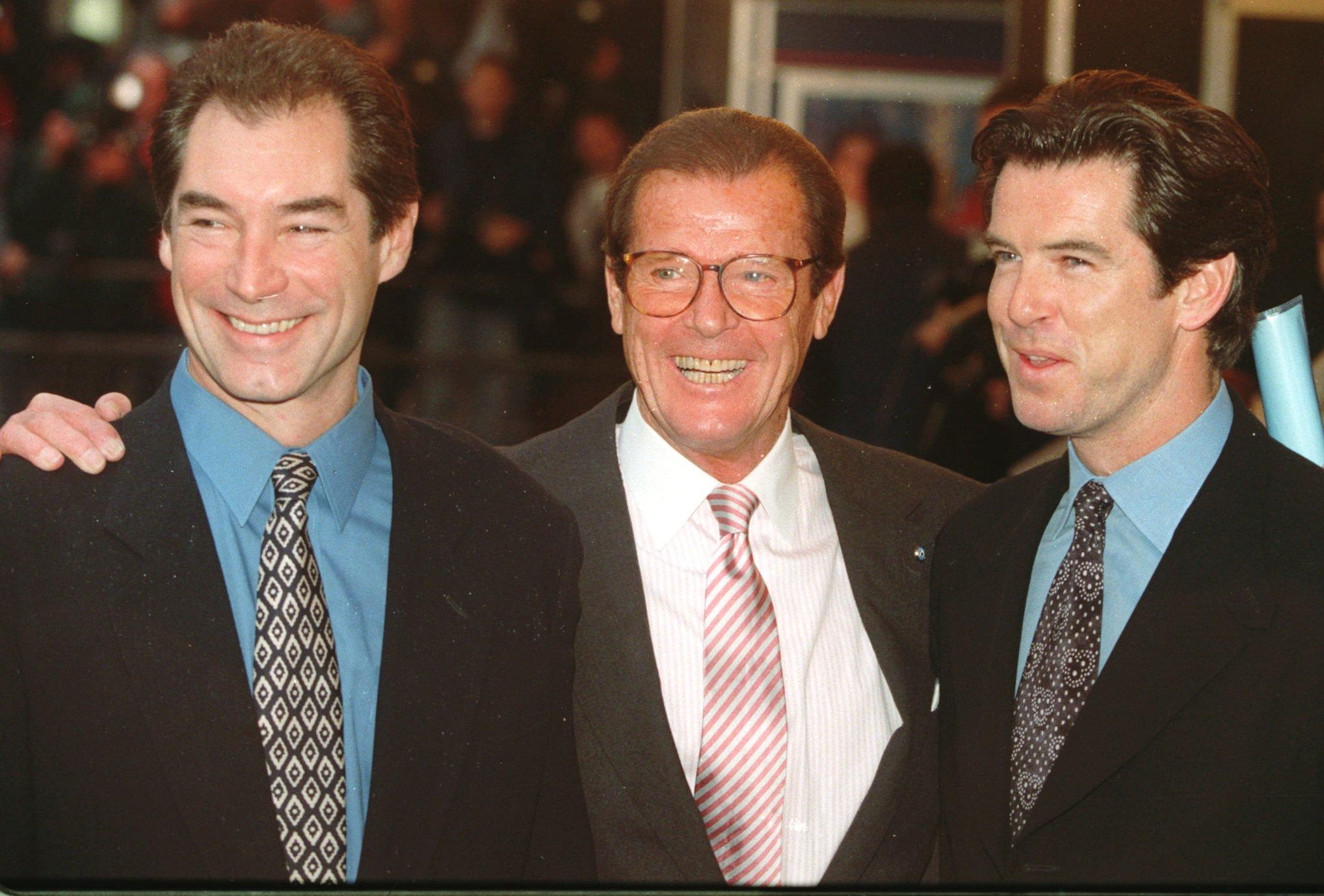 "Timothy Dalton left, Roger Moore and Pierce Brosnan, three of the actors who have portrayed the English secret agent James Bond in the Bond movies line up at a central London cinema to celebrate the life of Albert R. ""Cubby"" Broccoli Sunday, Nov. 17, 1996. The American film producer Broccoli was responsible for the seventeen Bond movies from 'Dr. No' to the recent 'Goldeneye'.(AP Photo/Alastair Grant)"