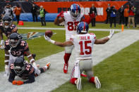 New York Giants wide receiver Golden Tate (15) celebrates a touchdown with wide receiver Sterling Shepard (87) during the second half of an NFL football game against the Chicago Bears in Chicago, Sunday, Nov. 24, 2019. (AP Photo/Charles Rex Arbogast)