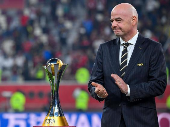 Fifa president Gianni Infantino presents the Club World Cup trophy (Getty)