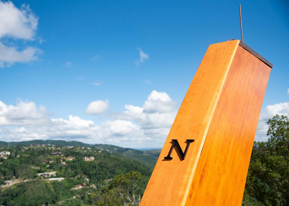 A wooden pillar indicates the cardinal point of north at the grand opening of Anakeesta's new AnaVista Tower in Gatlinburg, Tenn., on Wednesday, July 8, 2020.