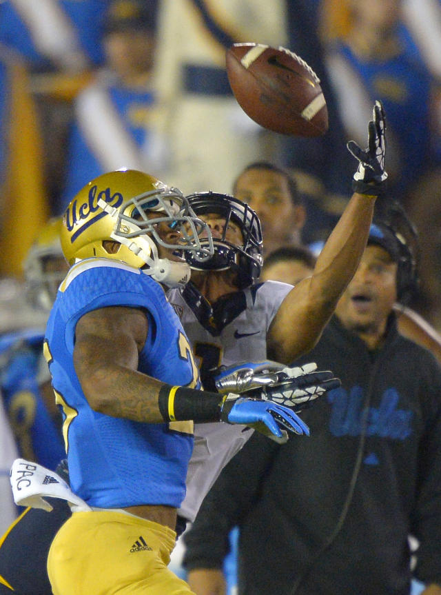 California wide receiver Bryce Treggs, right, makes a catch as UCLA safety Brandon Sermons defends during the first half of their NCAA college football game, Saturday, Oct. 12, 2013, in Pasadena, Calif. (AP Photo/Mark J. Terrill)