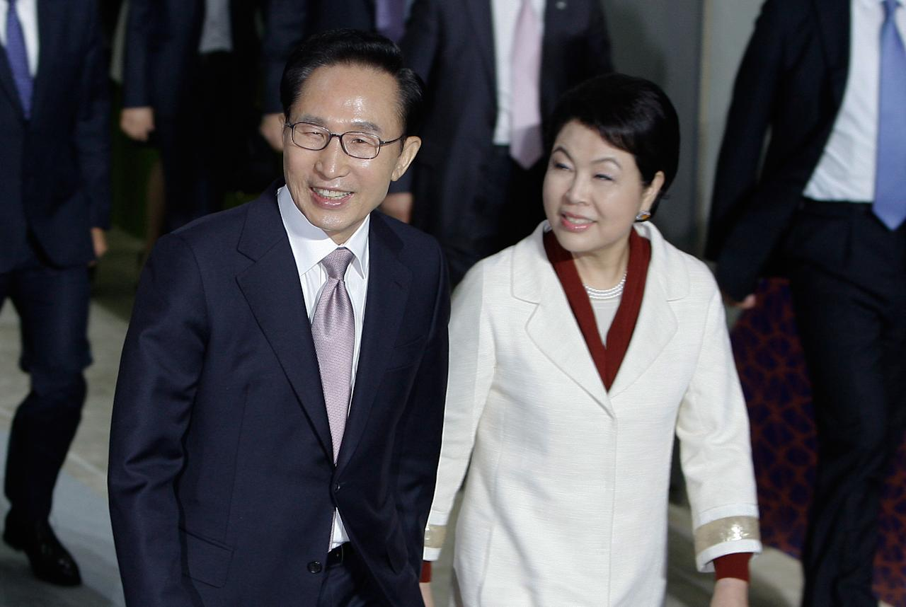 YEOSU, SOUTH KOREA - MAY 11:  South Korean President Lee Myung-Bak and his wife Kim Yoon-Ok attend at the opening ceremony of the 2012 Yeosu Expo on May 11, 2012 in Yeosu, South Korea. More than 105 countries, 10 International Organizations and 10 million visitors are expected to participate in the expo that will open to the public on May 12 to August 12.  (Photo by Chung Sung-Jun/Getty Images)