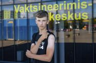 Joonas Leis , 12 years old boy, poses for a photo after getting a shot a coronavirus vaccine at a vaccination center inside a sports hall in Estonia's second largest city, Tartu, 164 km. south-east from Tallinn, Estonia, Thursday, July 29, 2021. Estonia's second largest city Tartu is making rapid progress in vaccinating children aged 12-17 ahead of the school year in September. Around half of the town's teenagers have already received their first vaccine, and local health officials are confident they will hit 70% in the coming 30 days. (AP Photo/Raul Mee)