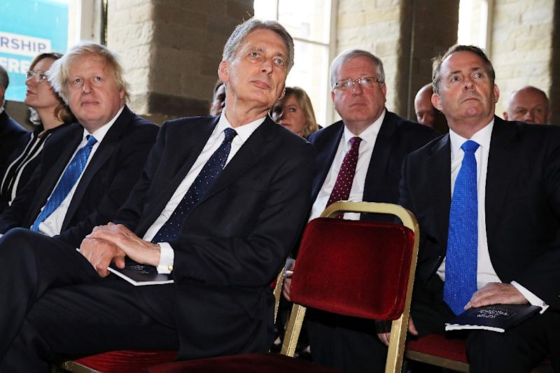 (From L) Foreign Secretary Boris Johnson, Chancellor of the Exchequer Philip Hammond and International Trade Secretary Liam Fox (R) listen to a speech during an event in Halifax, in May 2017