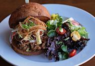 "<p><strong>Kalua Pork Sandwich</strong></p><p>You won't find this anywhere else in the country, and no one does this Hawaiian staple better than <a href=""https://www.konosnorthshore.com/"" rel=""nofollow noopener"" target=""_blank"" data-ylk=""slk:Kono's"" class=""link rapid-noclick-resp"">Kono's</a>. The pork is slow-roasted for twelve hours and served not only as a variation of sandwiches but also in a breakfast burrito, biscuit or nachos. Sandwiches include guava barbecue sauce, grilled onions, ham and bacon.</p>"
