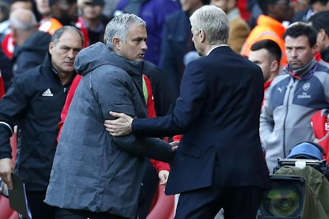 Arsenal manager Arsene Wenger shakes hands with Manchester United manager Jose Mourinho (2nd L) after Aresnal win the game 2-0 (AFP Photo/Ian KINGTON)