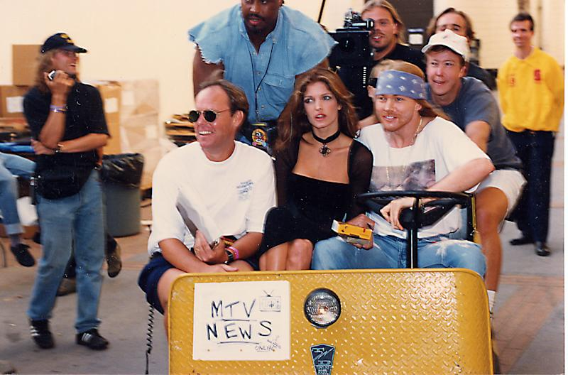 Stephanie Seymour (center) and Axl Rose (right) at the 1992 MTV Video Music Awards. (Photo: Jeff Kravitz/FilmMagic)