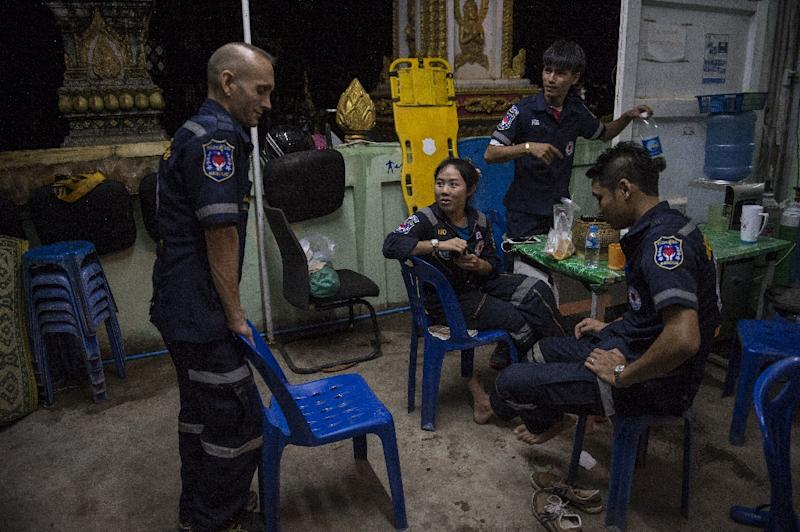 Vientiane Rescue volunteers rest between callouts at one of their outposts in Vientiane, Laos (AFP Photo/Lillian Suwanrumpha)