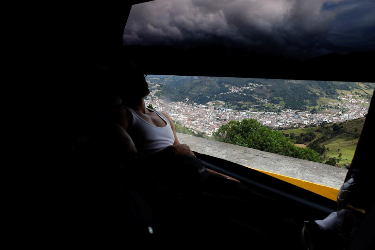 "Abrahan Bastidas, 26, an I.T. specialist, looks through the window while he travels by bus from Caracas to Chile in Pamplona, Colombia, November 8, 2017. For Abrahan, the trigger to leave came mid-year when his employer, a Caracas hotel, decided it could no longer provide him with breakfast and dinner. Suddenly, all his income was going towards food. ""As a professional it was impossible to continue like that"" he said. REUTERS/Carlos Garcia Rawlins  SEARCH ""RAWLINS BUS"" FOR THIS STORY. SEARCH ""WIDER IMAGE"" FOR ALL STORIES."