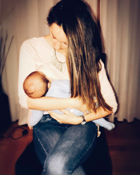 Peter Andre shared this sweet snap of his wife breastfeeding their newborn, but it hasn't gone down well with everyone [Photo: Instagram/Peterandre]