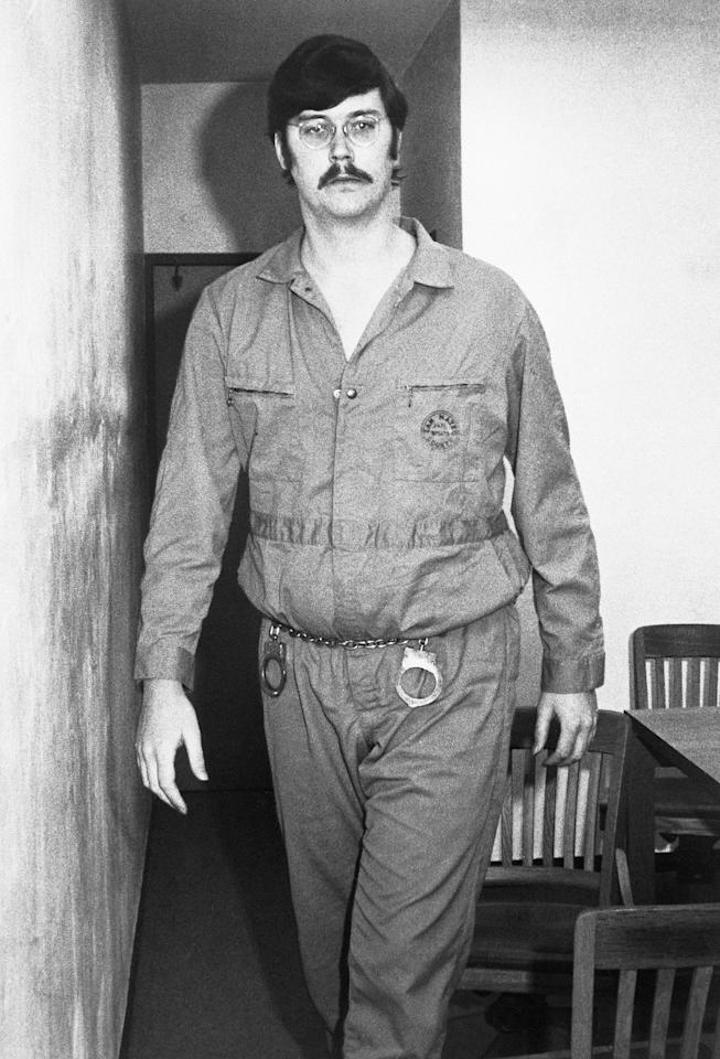 """The towering """"Co-Ed Killer"""" murdered his own grandparents at the age of 15 (after which he was declared a paranoid schizophrenic), and he eventually killed his mother and her friend. But he is most known for slaying teen and college-aged women in a Southern California spree that lasted from May 1972 to February 1973: Mary Anne Pesce, Anita Luchessa, Aiko Koo, Cindy Schall, Rosalind Thorpe and Alice Liu. He turned himself in to police after killing his mom (whom he claimed was abusive during his childhood), and season 1 of <em>Mindhunter</em> focused on his hauntingly matter-of-fact conversations with Special Agent Holden Ford (Jonathan Groff). When season 2 picks up, Holden is in the throes of a panic attack after Kemper's (Cameron Britton) bone-chilling bear hug. Beyond killing his victims, Kemper was known for necrophilia and dismembering their bodies. Now 70 years old, he <a href=""""https://www.oxygen.com/kemper-on-kemper-inside-the-mind-of-a-serial-killer/crime-time/ed-kemper-then-now"""">remains incarcerated</a> in Vacaville, California."""