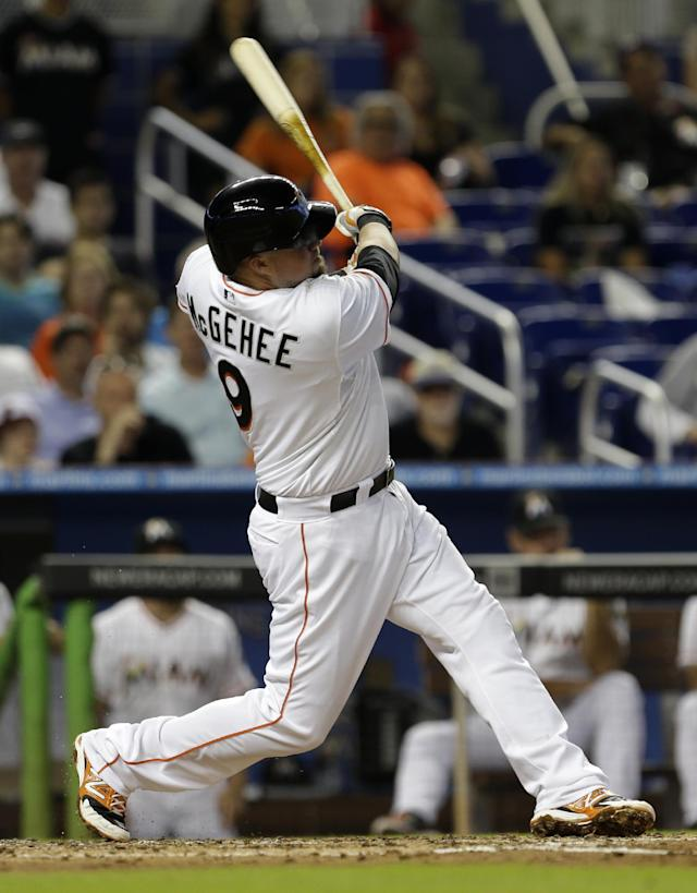 Miami Marlins' Casey McGehee (9) follows through on a base hit against the New York Mets in the fourth inning of a baseball game in Miami, Wednesday, May 7, 2014. (AP Photo/Alan Diaz)