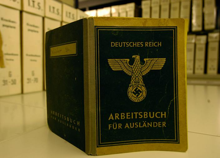 View of a 'Working Book For Foreigners' seen at the International Tracing Service in Bad Arolsen, Germany, Wednesday, April 19, 2006. (AP Photo/Bernd Kammerer, FILE)