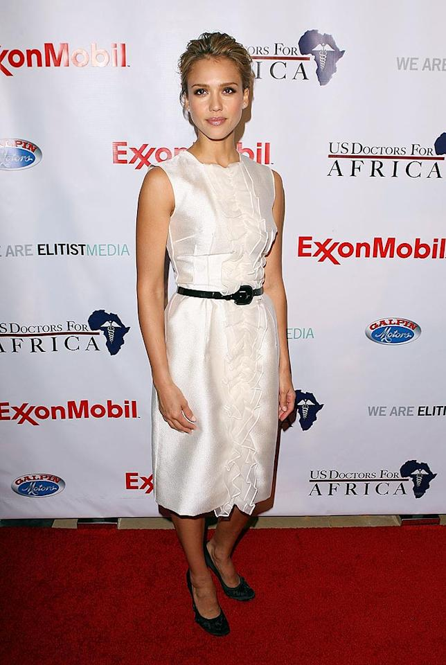"Jessica Alba keeps it simple yet chic in a belted white sheath, classy updo, and black pumps. Jesse Grant/<a href=""http://www.wireimage.com"" target=""new"">WireImage.com</a> - April 21, 2009"