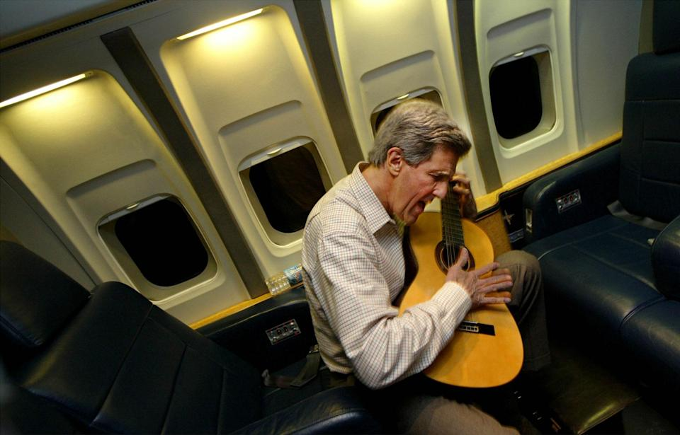 <p>Democratic presidential canidate Senator John Kerry (D-MA) plays his guitar February 18, 2004 in flight enroute to Washington, DC. from Los Angeles, CA. (Photo by Chris Hondros/Getty Images) </p>