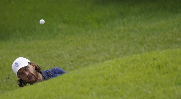 Tommy Fleetwood of Great Britain plays a shot from a bunker on the 9th hole during the second round of the men's golf event at the 2020 Summer Olympics on Friday, July 30, 2021, at the Kasumigaseki Country Club in Kawagoe, Japan. (AP Photo/Matt York)