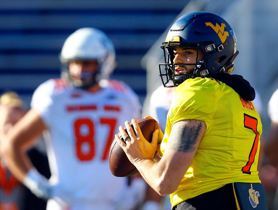 South quarterback Will Grier of West Virginia throws a pass during practice for the Senior Bowl (AP Photo)