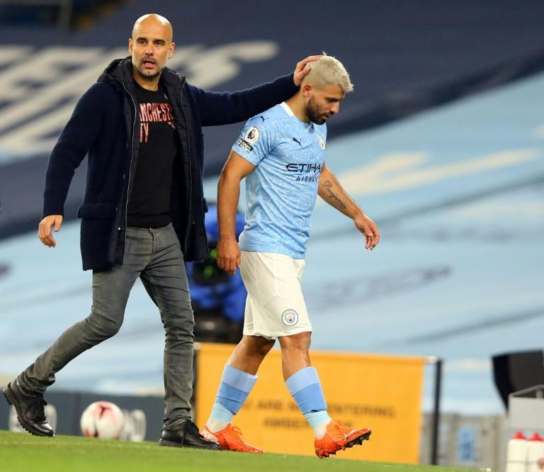 Manchester City striker Sergio Aguero (R) and his manager Pep Guardiola