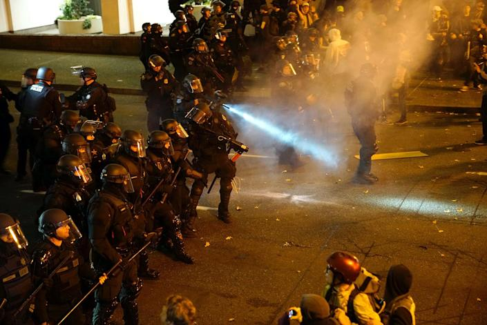 <p>A police officer sprays the crowd with an irritant during a protest against the election of Republican Donald Trump as President of the United States in Portland, Oregon, U.S. November 12, 2016. (REUTERS/William Gagan) </p>