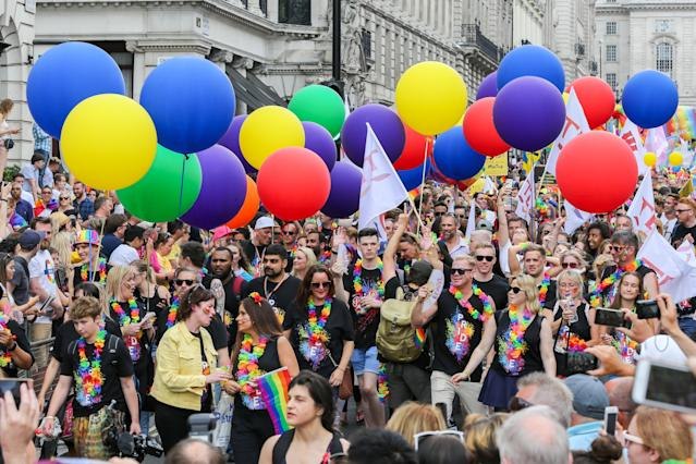 Huge crowd of participants with rainbow colour balloons during the parade. Photo: Dinendra Haria/SOPA Images/LightRocket via Getty Images