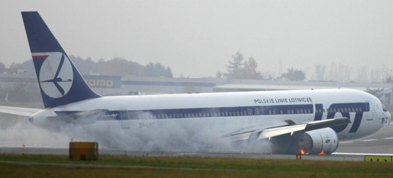 A Boeing 767 of Polish LOT airlines makes an emergency landing at Warsaw airport, Poland, Tuesday, Nov. 1, 2011. The plane was en route from Newark with 230 people on board but no one was injured. (AP Photo)  POLAND OUT