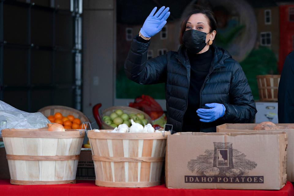 Vice President-elect Kamala Harris waves as she arrives to pack grocery bags for those in need of food while volunteering in the National Day of Service, Jan. 18, 2021, at Martha's Table in southeast Washington, D.C.