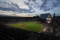 A crowd watches the fifth inning of a baseball game between the Baltimore Orioles and the Toronto Blue Jays, Friday, June 18, 2021, in Baltimore. (AP Photo/Julio Cortez)