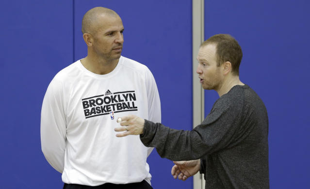 FILE - In this Wednesday, Oct. 2, 2013, file photo, Brooklyn Nets coach Jason Kidd, left, and assistant coach Lawrence Frank talk during NBA basketball training camp at Duke University in Durham, N.C. Kidd has been suspended for two games for pleading guilty to driving while ability impaired. The NBA announced on Friday, Oct. 4, 2013, that Kidd will miss the first two games of the regular season starting on Oct. 29. (AP Photo/Gerry Broome, File)